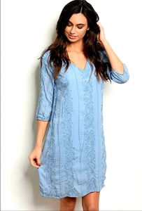 V-neck floral embroidered tunic dress.