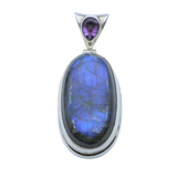 An oval-shaped cabochon Labradorite pendant with Amethyst