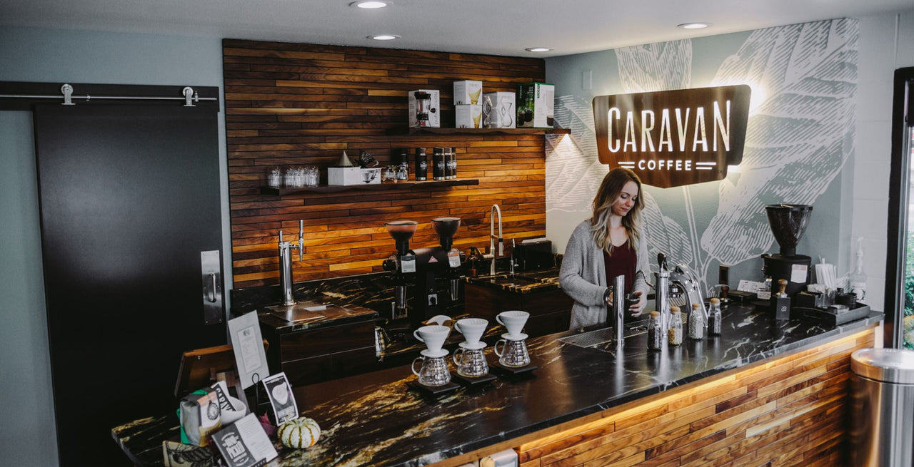 Caravan Coffee counter with barista making coffee