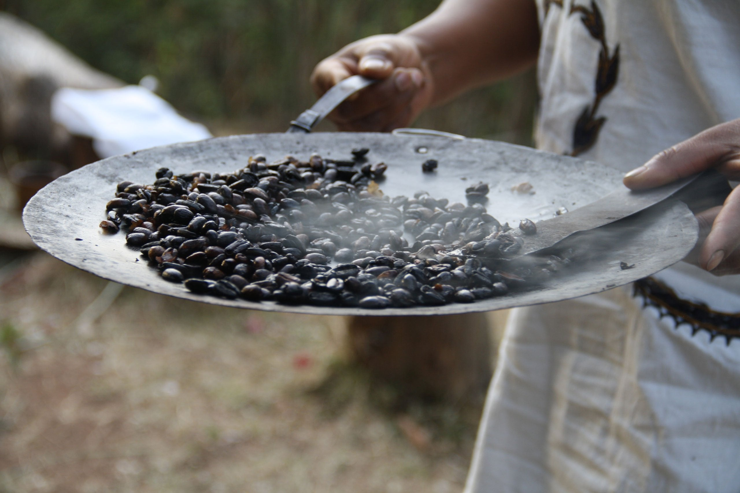 roasting coffee on a metal dish