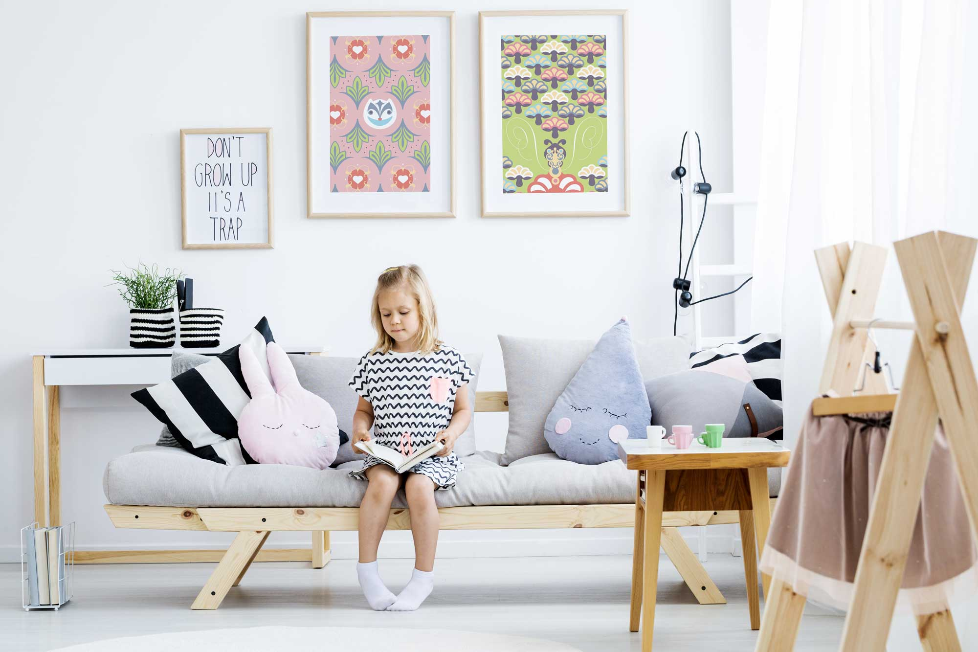 Alice's Adventures in Wonderland limited edition prints hang in a child bedroom