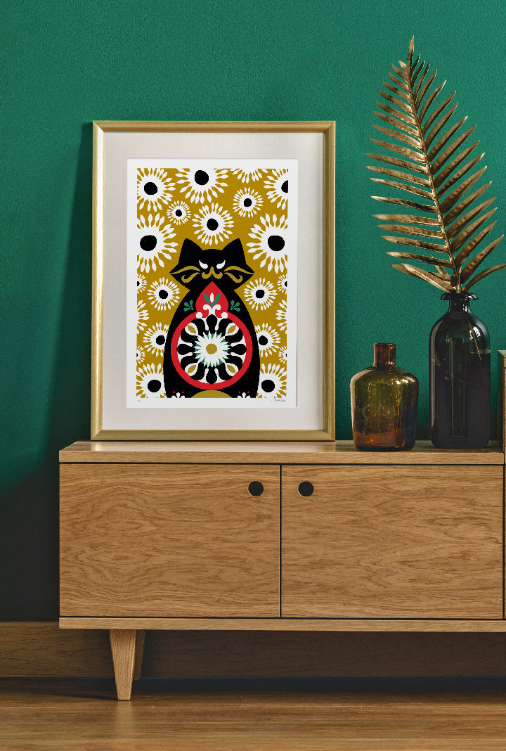 Limited edition print of Behemoth on green wall and gold frame.