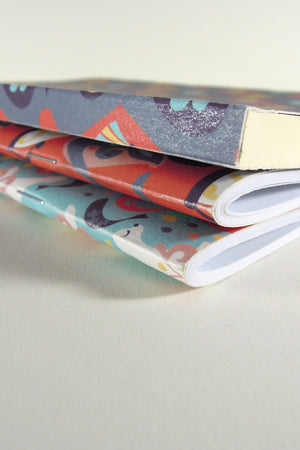 Alice in Wonderland notebooks and artbook binding detail