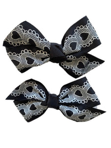 Black Bow with White Lace Hearts