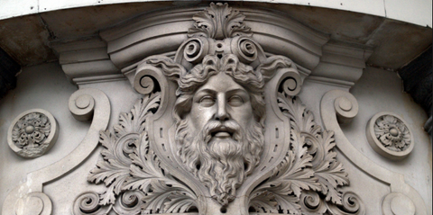 the green man face on a building in architecture pagan face