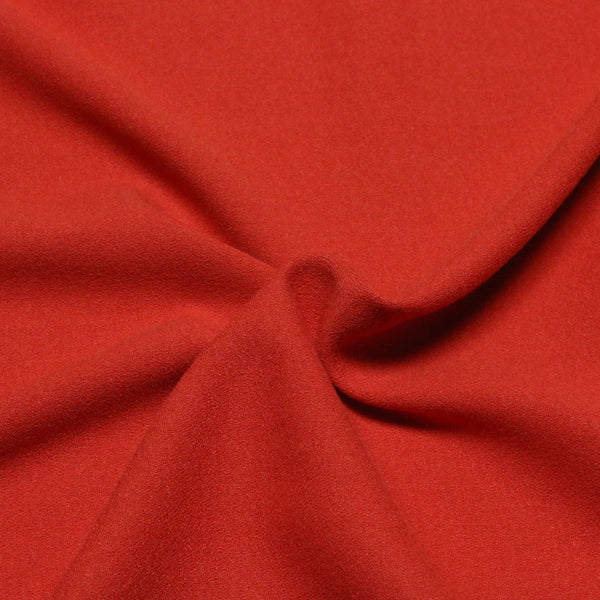 poly-spand-crepe-2350-8087-burnt-orange. Fabric Focus