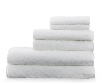 Load image into Gallery viewer, Snow - white Enso washcloths and hand towels stacked on top of our bamboo luxury towels