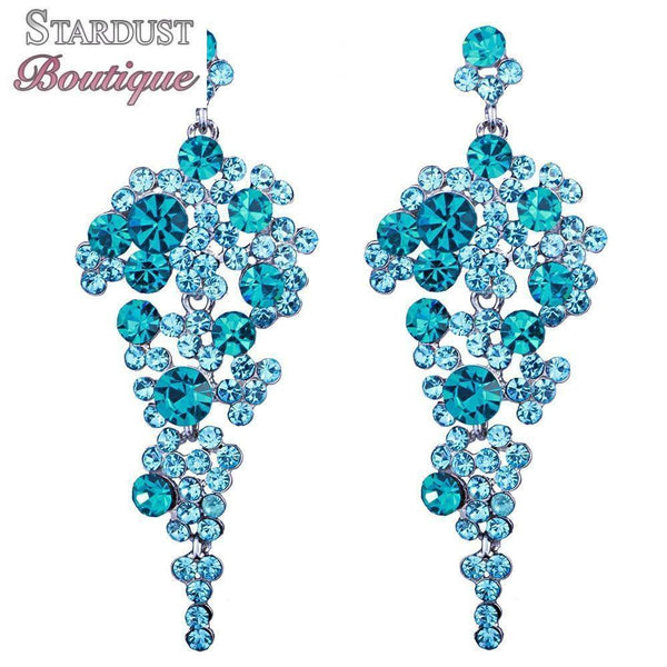 Drop pageant earrings in yellow, silver, pink, blue and more.