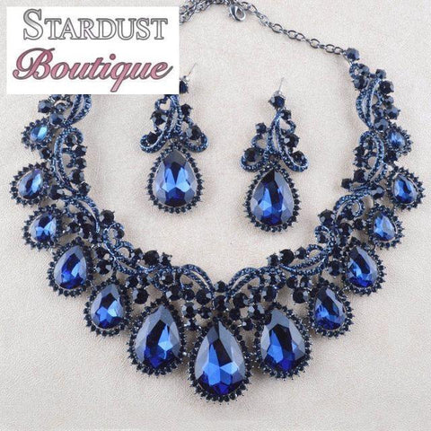 Luxury crystal necklace and earrings pageant set in red, black, blue and more.