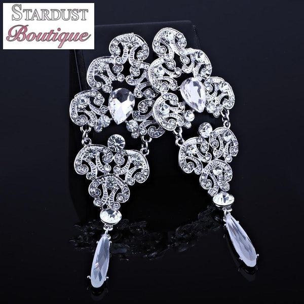 Drop pageant earrings in silver