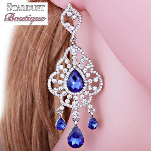 Drop pageant earrings in blue, red and silver.