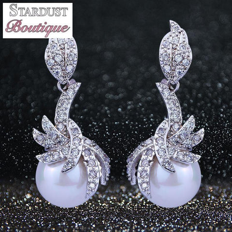 Pearl and cubic zirconia earrings in silver.