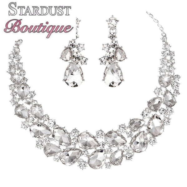 Luxury rhinestone crystal necklace and earrings pageant set in silver, black, blue and red.