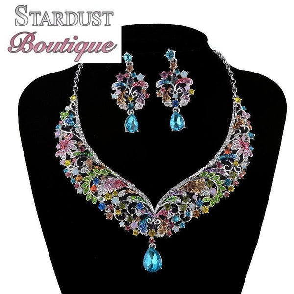 Luxury crystal necklace and earrings pageant set in multi, green, black, red and more.