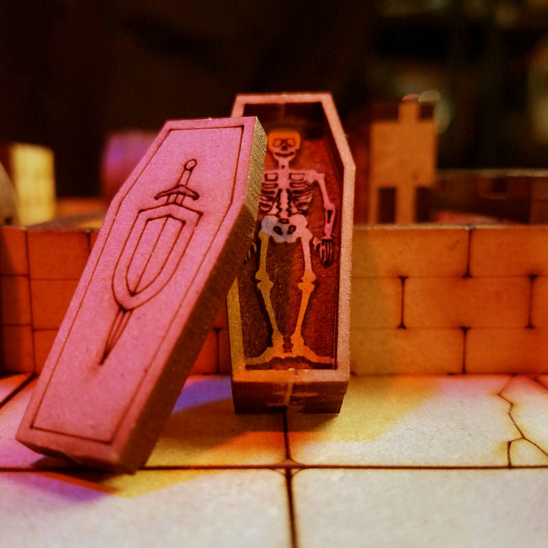 coffin standing against wall with open lid and skeleton inside