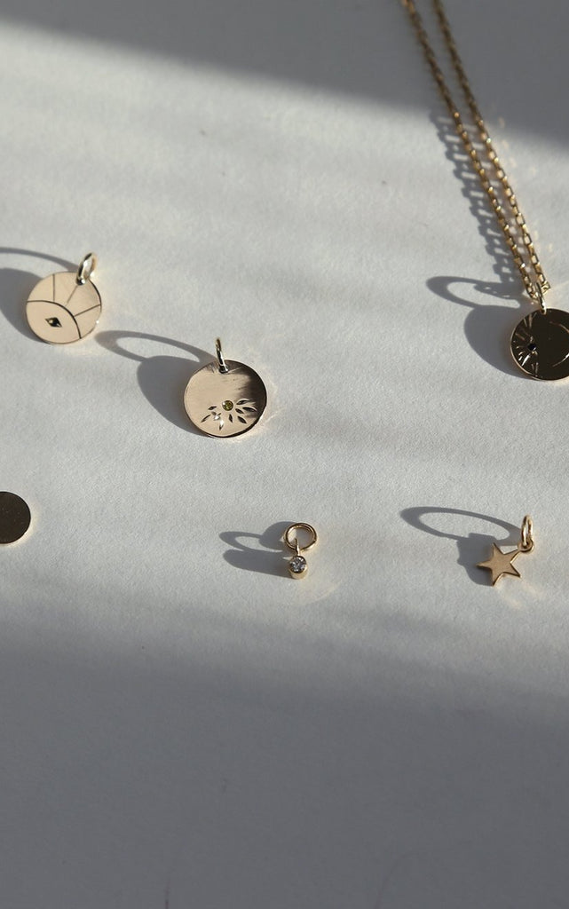 Charms and pendants in solid gold handmade by Adriana Chede Jewellery