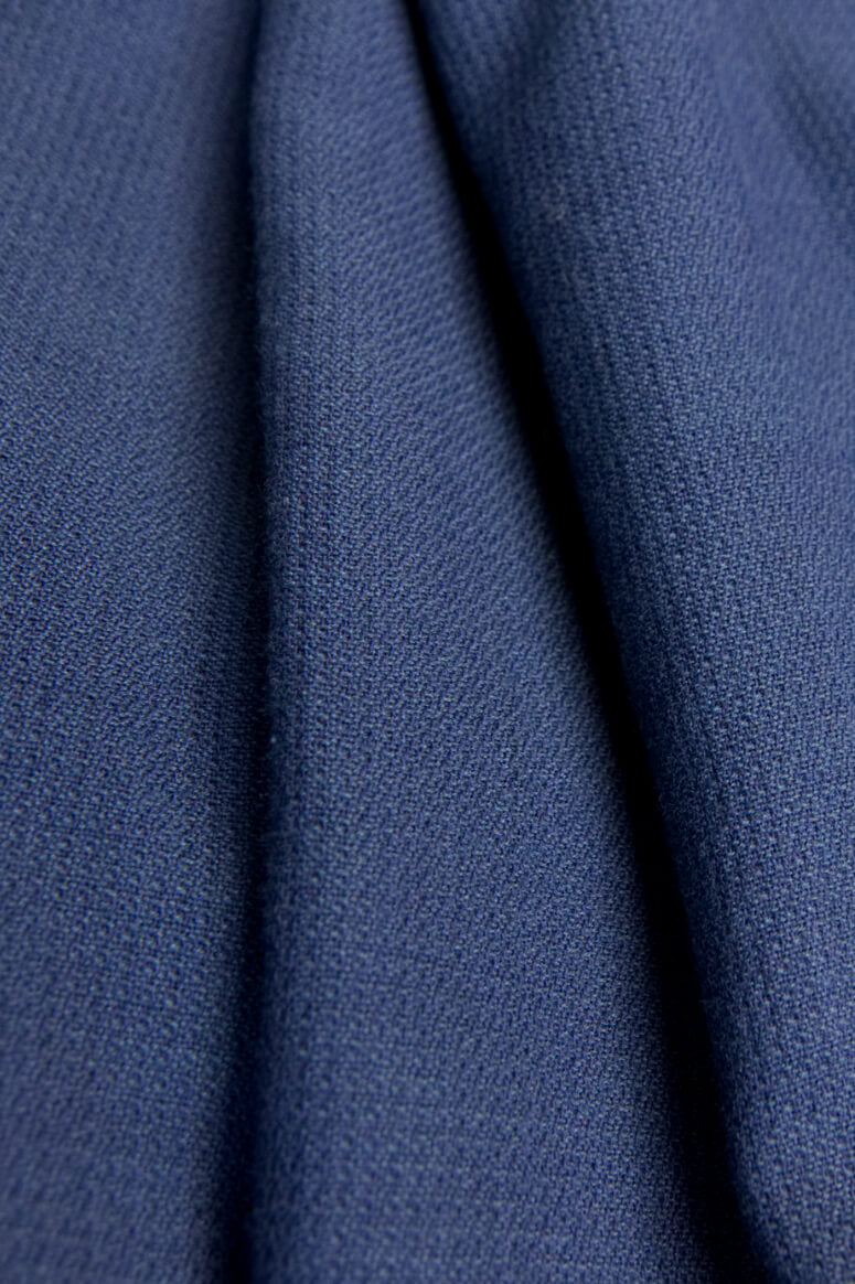 Taylor Tall close up of navy fabric for drop shoulder button down top for tall women