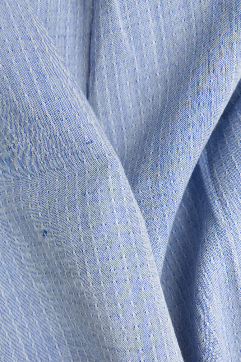 Taylor Tall close up of blue fabric for structured top for tall women