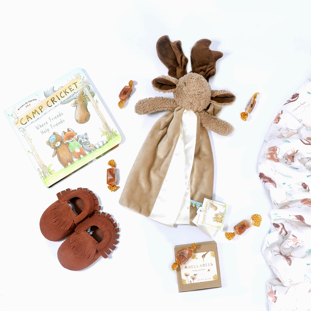 Bruce the Moose Baby Gift Box  with lovey, Camp Cricket matching book, leather moccasins, wilderness swaddle and anellabees handmade caramels- eku Box