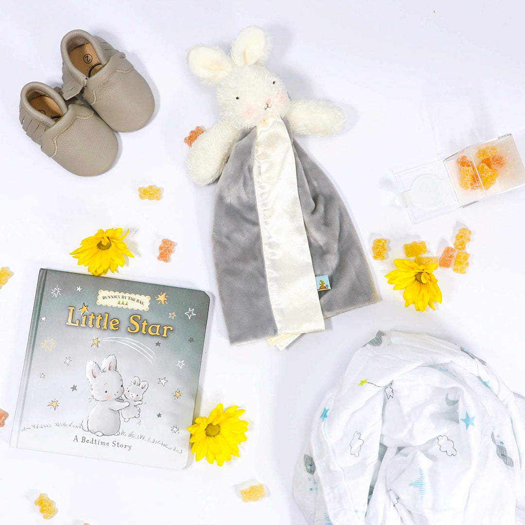 Welcome Baby in neutral grey with lovey, matching little star book, leather moccasins, starry night swaddle and Sugarfina candies - eku Box