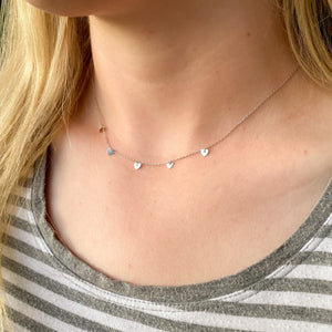 tiny heartstrings necklace