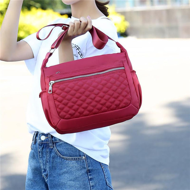 135109 Lingge embroidery line new Korean version of the middle-aged shoulder bag tide Mummy bag