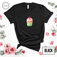 Load image into Gallery viewer, cute cupcake on a black shirt mockup with flowers