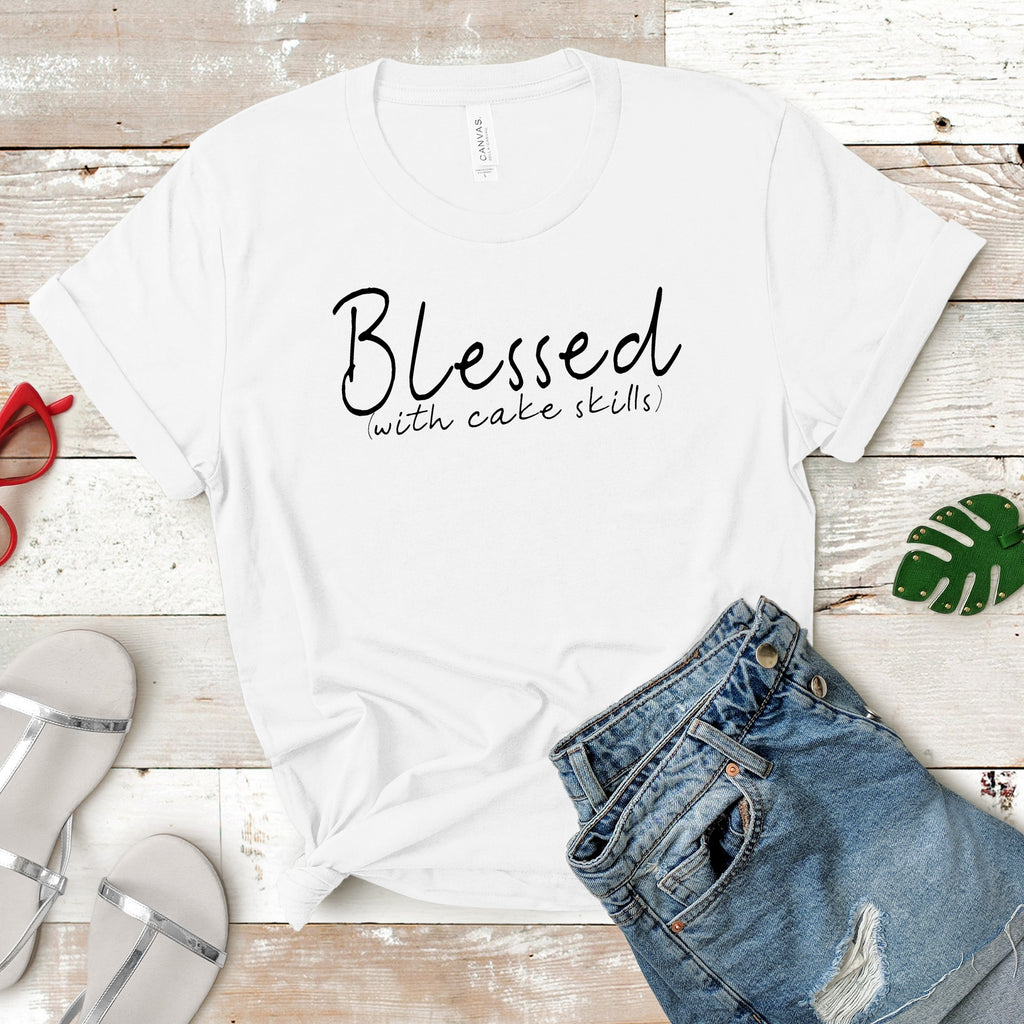 Blessed with cake skills white tshirt on wood background