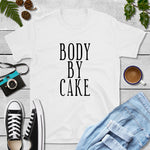Body by cake white tshirt on wood background