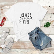 Load image into Gallery viewer, cakers gonna cake white tshirt on wood background