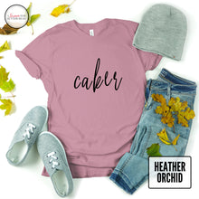 Load image into Gallery viewer, heather orchid caker thsirt mockup with jeans