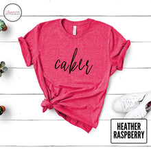 Load image into Gallery viewer, heather raspberry caker tshirt on white wood background