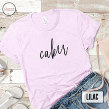 Load image into Gallery viewer, lilac caker tshirt mockup on light wood background