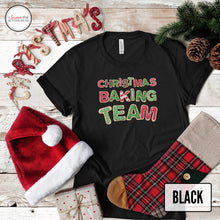 Load image into Gallery viewer, Christmas baking team black shirt on christmas background