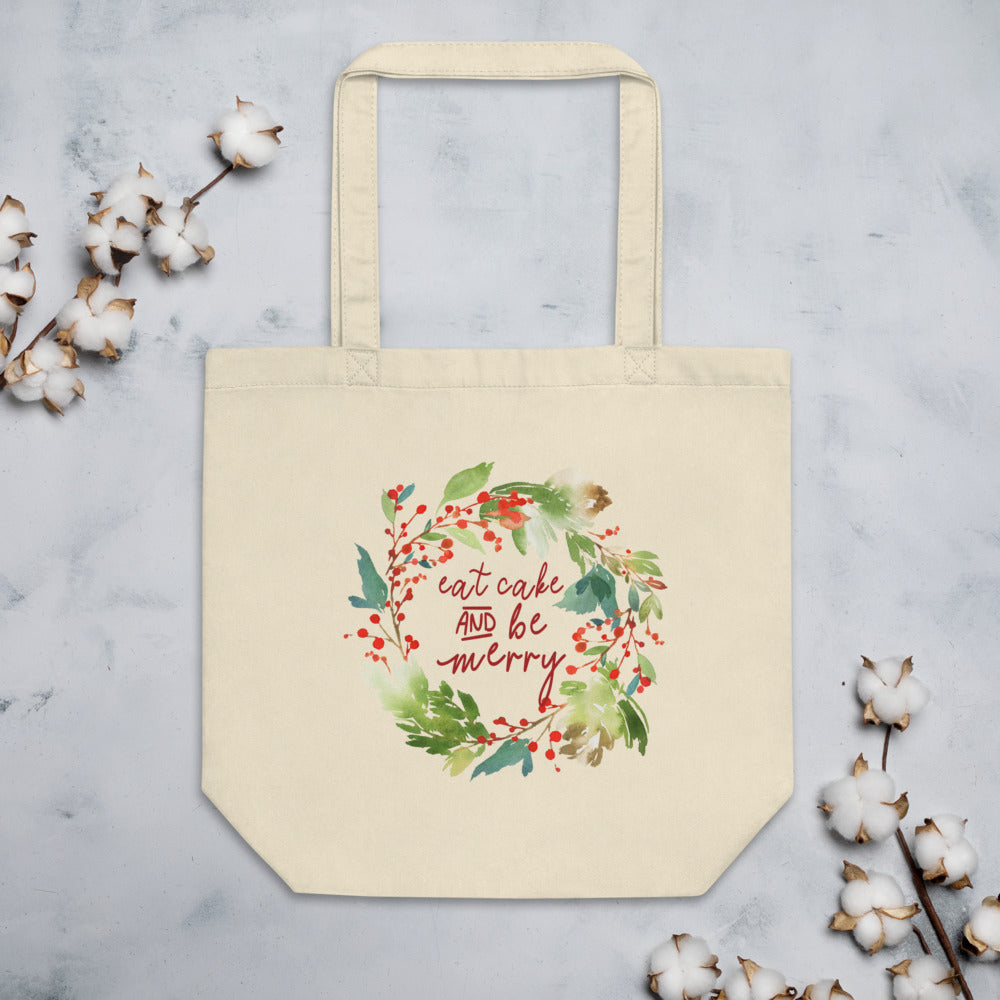 Eat Cake and Be Merry Tote Bag on a gray background