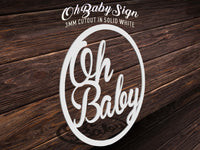 Oh Baby cutout sign placed on top of wood table for event decoration