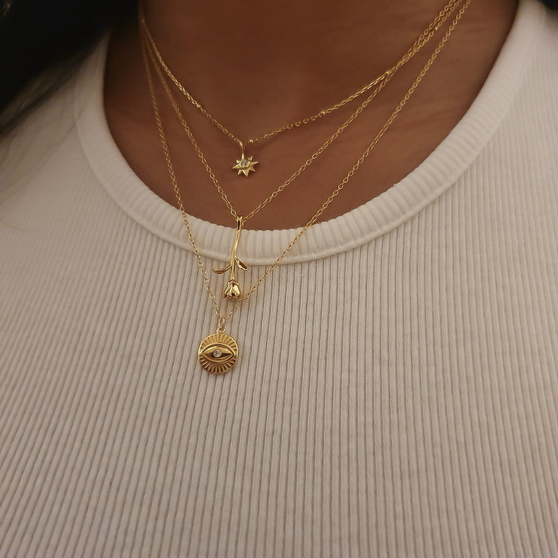 Gold Star Burst Necklace, gold pendant chain, layering gold necklaces, uk jewellery brand, , demi fine jewellery, dainty gold necklace, womens jewellery uk, delicate jewellery