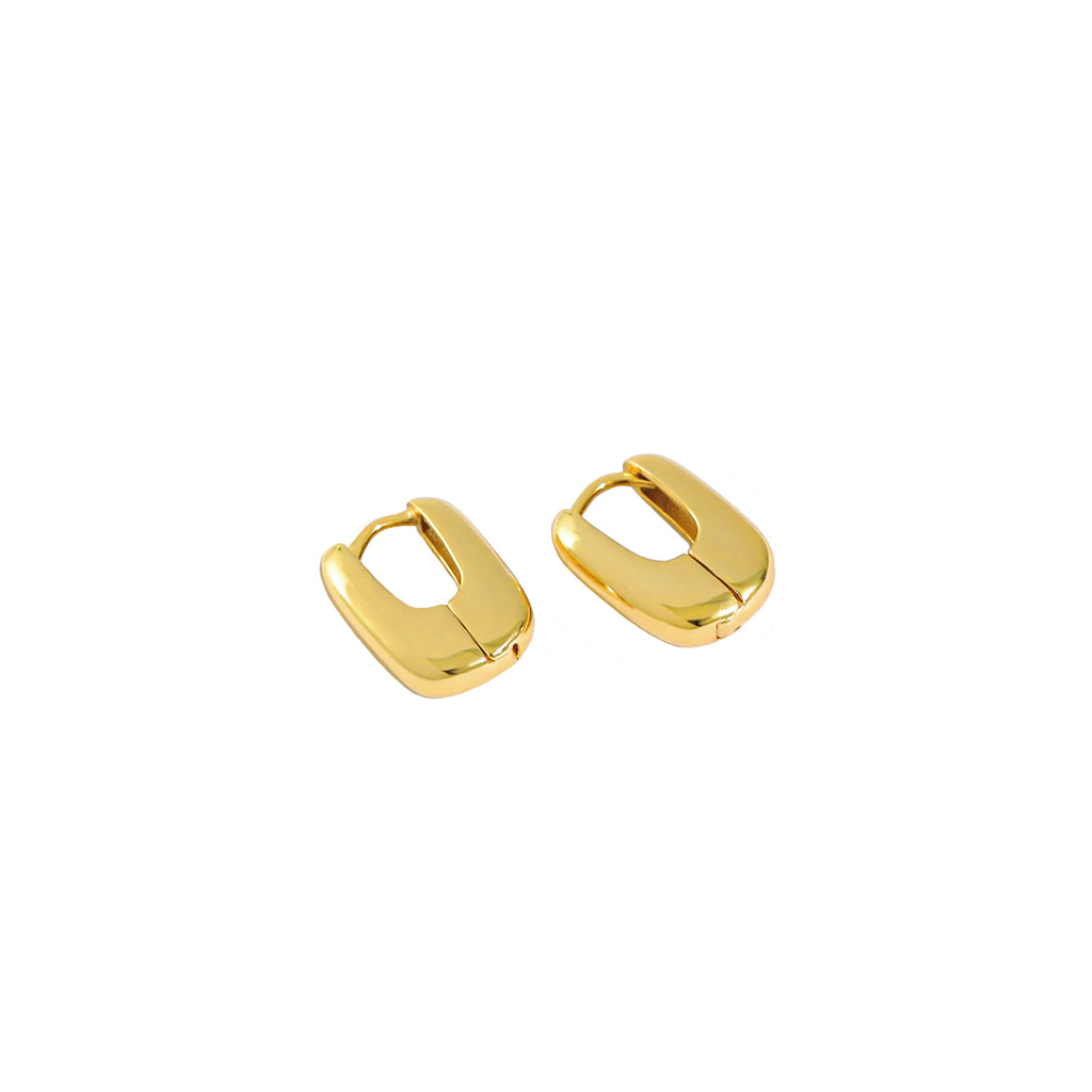 Thick Gold Oval Huggie Earrings, ear huggue, hoops, ear stacks, stacking hoops, womens earrings, uk jewelelry brand, gold vermeil jewellery, gold vermeil hoops, gold vermeil earrings