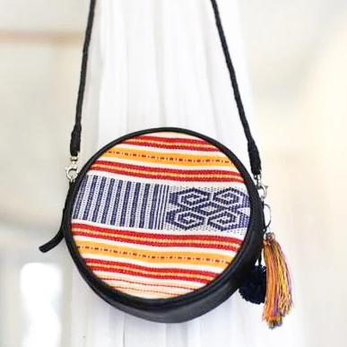 LEATHER BAG ROUND ( IKAT ) - AMBER
