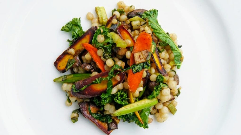 Pearl couscous with vegetables and garlic scapes