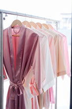 Rack of Silk Robes