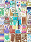 a mosaic of hand-carved stamps in many different colors and designs. made by hand and inspired by song lyrics.
