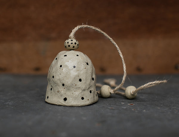 HAND PINCHED CERAMIC BELL - BLACK POLKA DOT - SANDY CLAY
