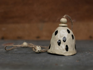 HAND PINCHED CERAMIC BELL - BLACK SPOTS- SANDY CLAY
