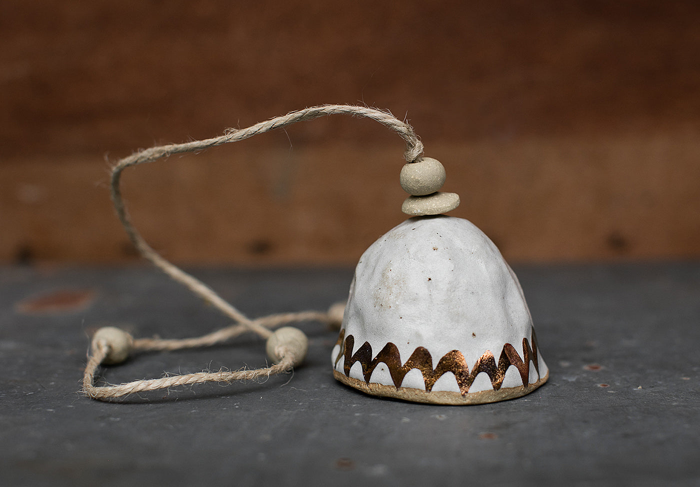 HAND PINCHED CERAMIC BELL - COPPER RAINBOW - SANDY CLAY - WHITE GLAZE