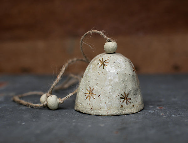 HAND PINCHED CERAMIC BELL - GOLD STAR - SANDY CLAY - CLEAR GLAZE