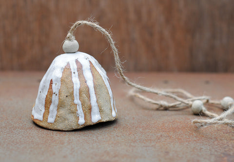HAND PINCHED CERAMIC BELL - SANDY CLAY - WHITE DRIBBLE GLAZE