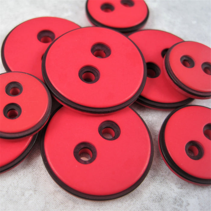 Red button with black edging