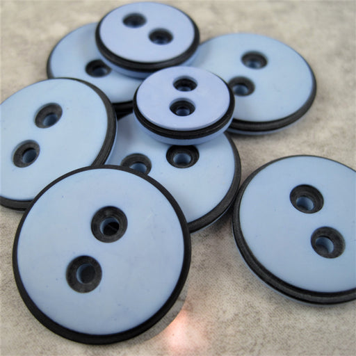 Pale blue button with black edging