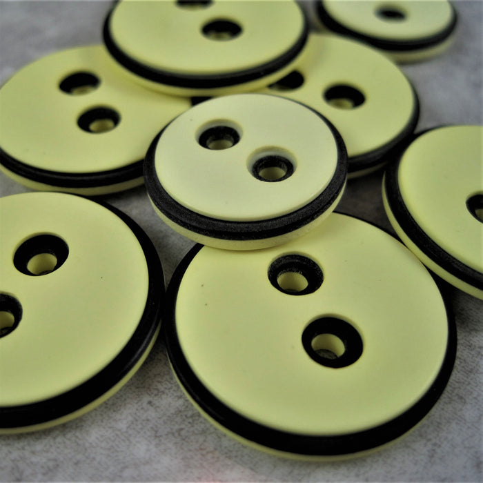 Lemon button with black edging